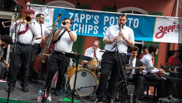 Hal Smith's On the Levee Jazz Band performs on Bourbon Street at the 2019 French Quarter Festival in New Orleans. From left, Clint Baker, Joshua Gouzy, Ben Polcer, Hal Smith, Joe Goldberg, Alex Belhaj, and Kris Tokarski. Photo by Megan Gouzy; courtesy Hal Smith