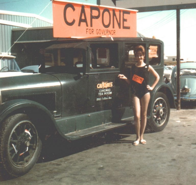 Capone's old car w- girl and campaign sign