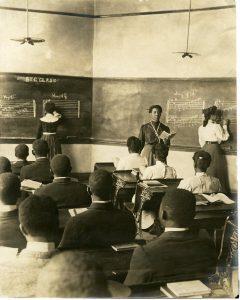 Tuskegee Institute teacher Mrs. Emily Moore Neely teaching her music class, circa (1920) .