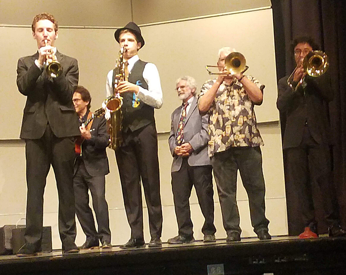 Richard Simon and the MBHS kids on stage at the school