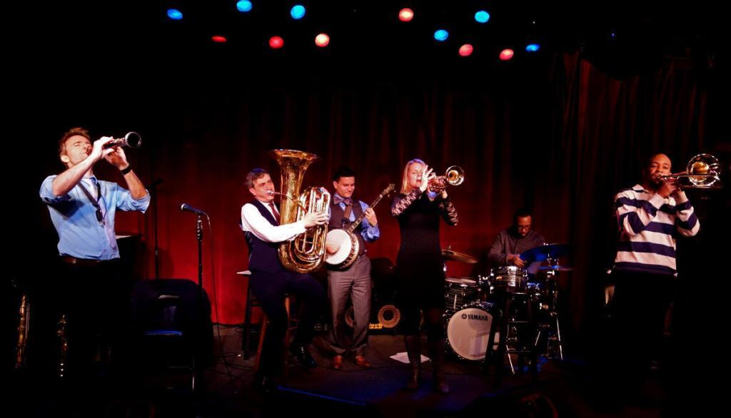 The Louis Armstrong Eternity Band keeps the traditional jazz flame alive at NYC's Birdland. From left: Adrian Cunningham, clarinet; David Ostwald, tuba; Vinny Raniolo, banjo; Bria Skonberg, trumpet; Marion Felder, drums; and Dion Tucker, trombone. (photo by Michael Friedman)