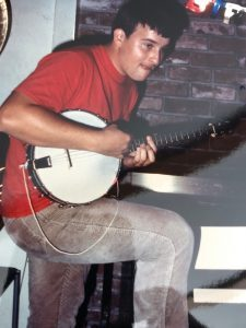 Clint with his first banjo, 1986