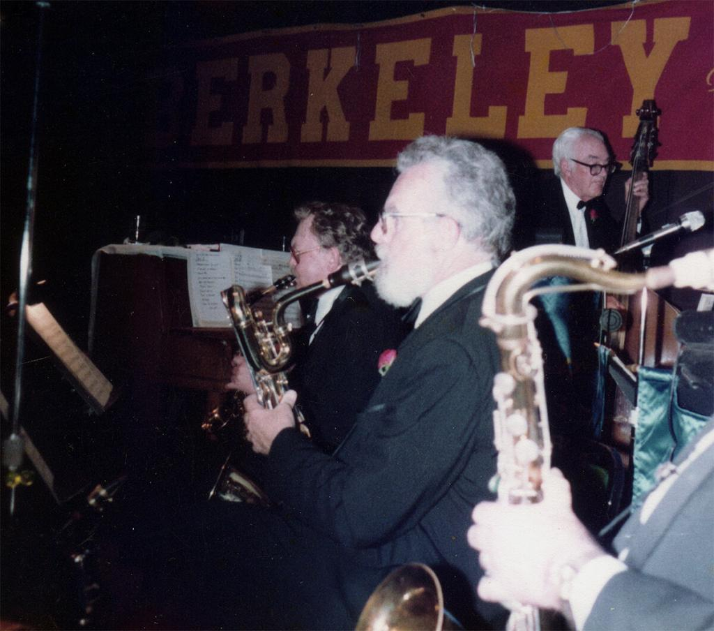 Pete Allen is seen playing baritone saxophone (center) and Dick Oxtot string bass in the Harbor Lights dance orchestra.
