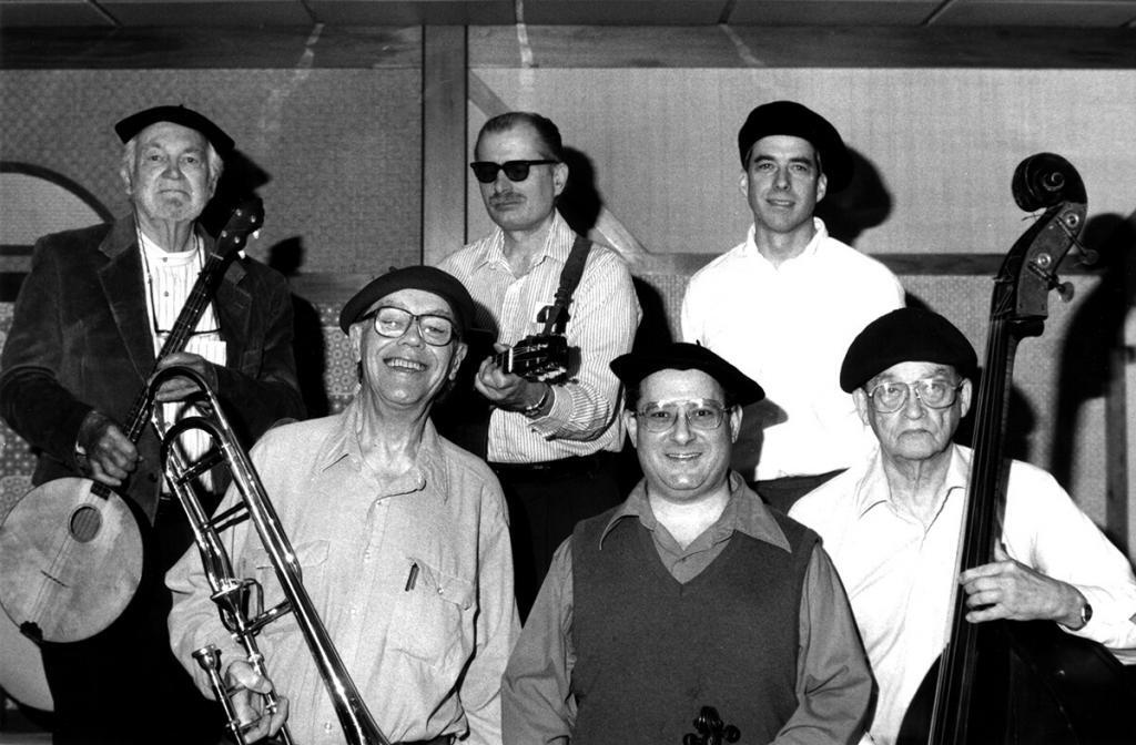 An Oxtot group at the Jack Tar Hotel, San Francisco, 2.16.97. L to R, front row: Bill Bardin (trombone), Ray Landsberg (violin), Jim Cumming (bass); back row Dick Oxtot (banjola), B. Wilson (guitar) and Hugh O'Donnell (drums). Photo by Ed Lawless.