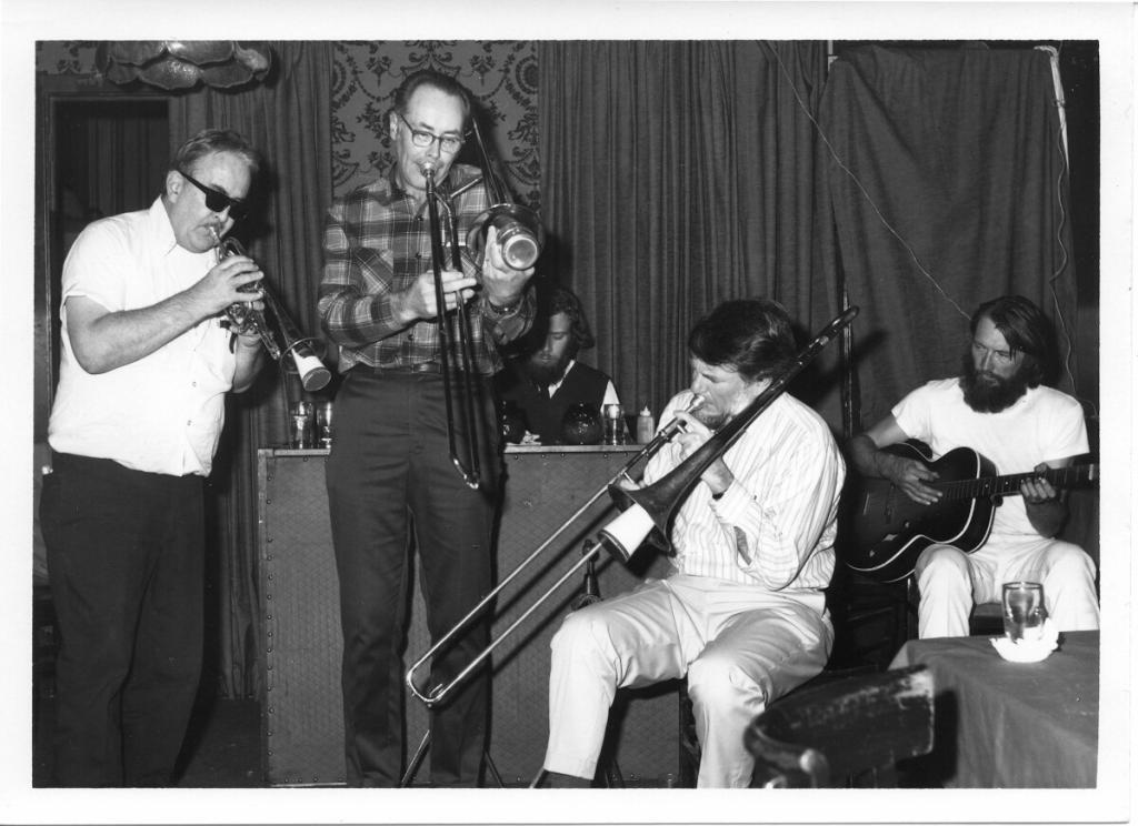 "P.T. Stanton (cornet), Bill Bardin and Bob Mielke (trombones), Ray Skjelbred (piano) and Ed Dickermann (guitar). ""P.T. Stanton Night"" at the Iron Duke Restaurant in San Francisco, 12.16.72."