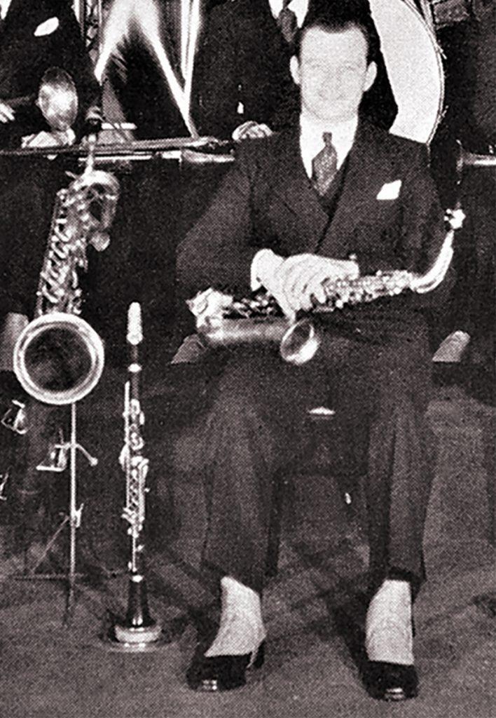 Clarence Hutchenrider with baritone sax, clarinet, alto sax and spats, 1930.