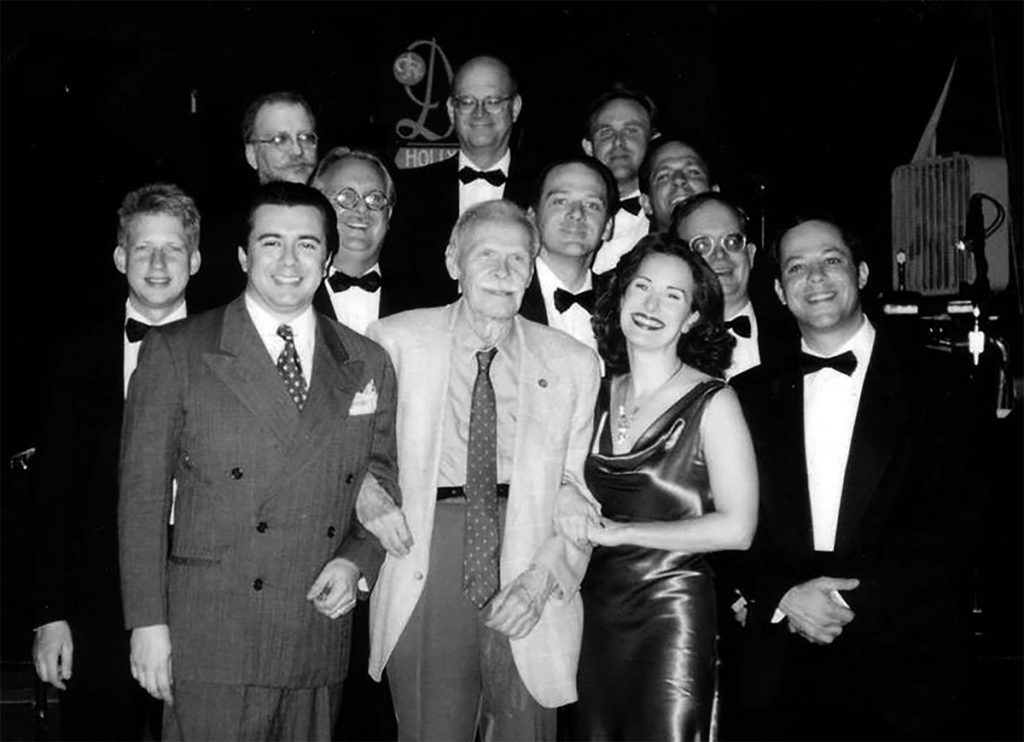 Spud with Dean Mora (left) and his orchestra c. 2000.