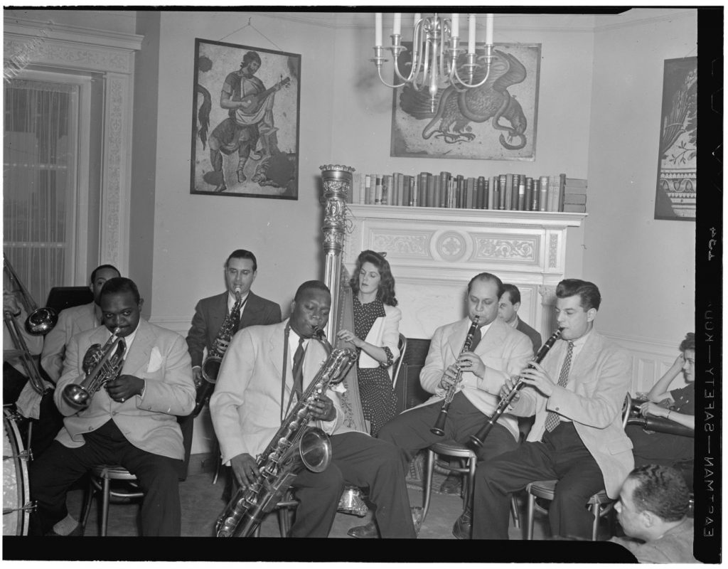 Johnny Hodges, Rex William Stewart, Adele Girard, Harry Carney, Barney Bigard, and Joe Marsala