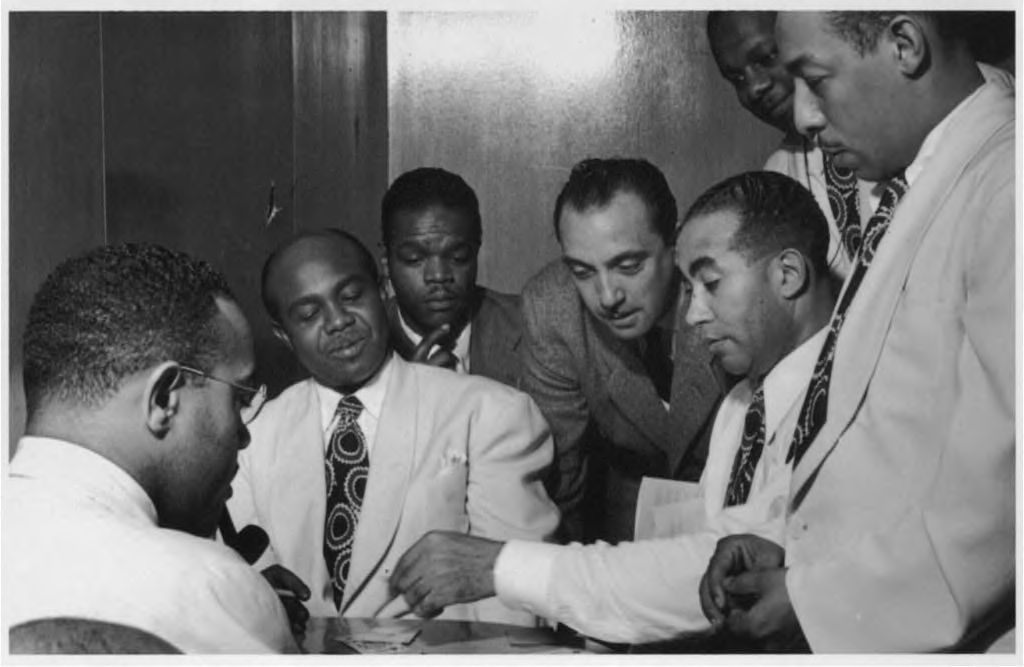 Al Sears, Shelton Hemphill, Junior Raglin, Django Reinhardt, Lawrence Brown, Harry Carney, and Johnny Hodges