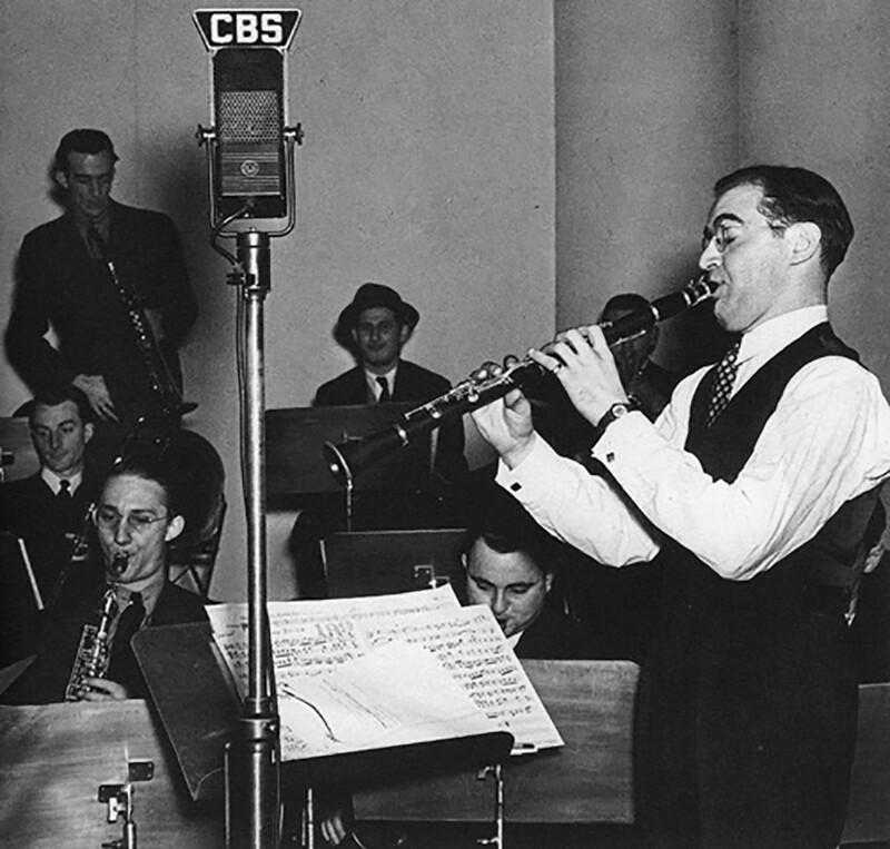 Benny Goodman on CBS radio; trumpet player Harry James is seen upper left.