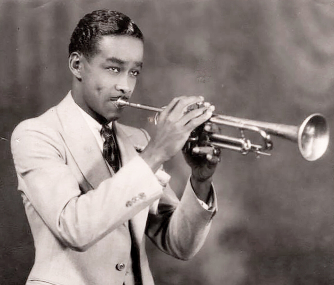 First professional trumpet gig in 1933 at age 21.