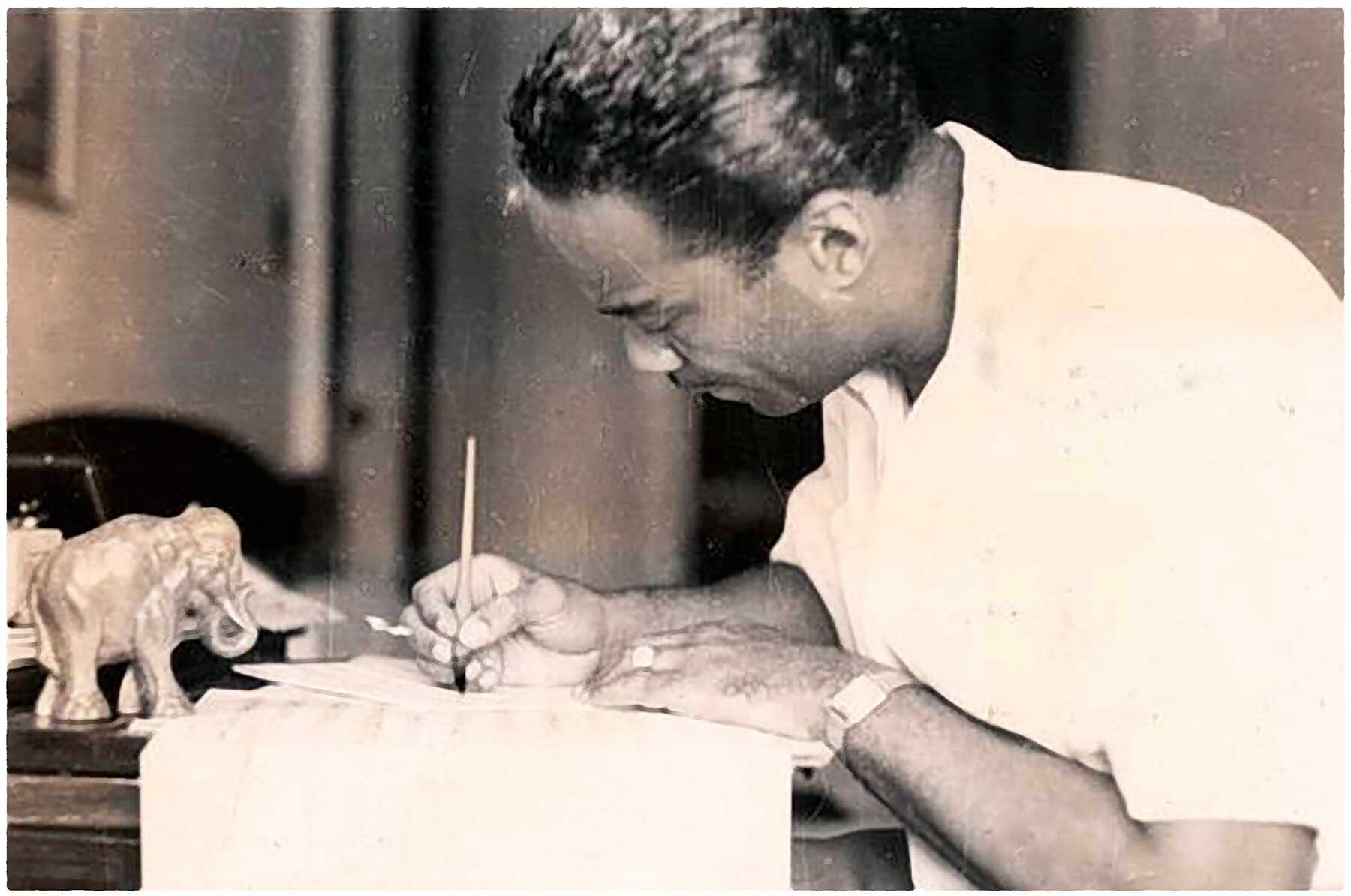 Buck composing or arranging, probably in China.