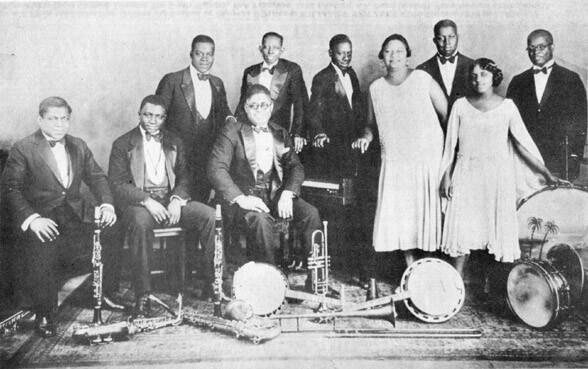 Clarence Williams and his Orchestra - left to right - Albert Socarras, Prince Robinson, Cyrus St. Clair, Clarence Williams, Buddy Christian, Charlie Irvis, Sara Martin, Floyd Casey, Eva Taylor, Ed Allen.